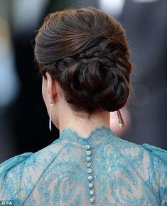 Duchess of Cambridge raised the style stakes with an intricate chignon.    The elegant knotted bun, put in place by a team from the Richard Ward salon in Chelsea, showed off the elaborate design of her teal Jenny Packham dress to full effect.    The tiny gems in the delicate lace across her back and shoulders shimmered as she arrived at a gala at the Royal Albert Hall to mark the countdown to the London Olympic Games.
