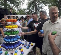Just-married same-sex couples reach for rainbow cupcakes baked by Oooh So Sweet Bakery after their mass same-sex wedding ceremony conducted during Baltimore Pride Festival! Congrats!