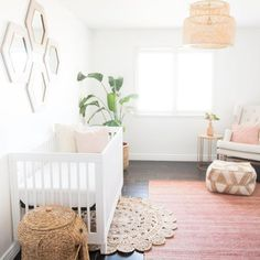 Modern bohemian style girl's nursery with a white, blush pink, and tan color scheme and featuring rattan decor - Baby Nursery Ideas & Children's Room Decor - photo by @marisabellephotography