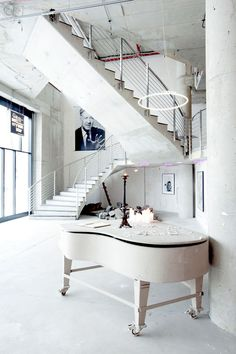 The NHow Hotel in Berlin?....love the way the staircase sweeps back on itself, almost creating a sculpture born out of itself...also liking the ever so subtle black accenting.