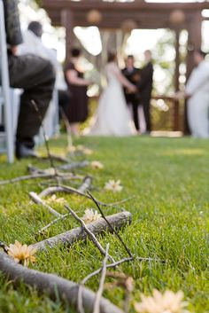 Rustic wedding decor for the aisle, love it! Hmm could we do something with branches inside the church??