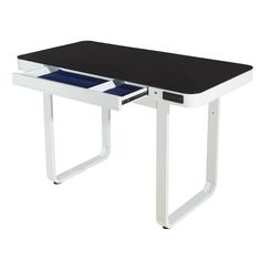 Technology and contemporary style merge in the trend-setting, this Hathor Writing Desk has tempered black glass top with rounded corners and glossy white metal U-shaped base will perfectly match all your favorite tech gear The slim drawer has a contrasting blue felt lining and has compartments for organization. Stream your music effortlessly as you pair your device to the wireless Bluetooth enabled inset speakers under the desk.