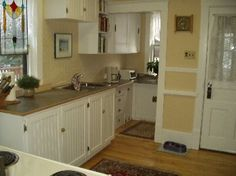 The kitchen after with beadboard style cabinetry