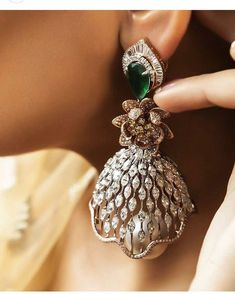 Meticulously crafted emerald and diamond earring by Khanna Jewellers