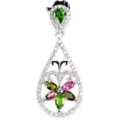 % 925 sterling silver emerald & topaz pendant  Gorgeous, hand made pendant with top stone % emerald  and pear shaped, set in % 925 sterling silver. With AAA CZ inlays and multicolored % topaz gem stones. Beautiful, dainty pendant. Has 1.27 carats of natural gem stones. Measures 34X14 mm. High quality gems. Very feminine & dainty. NWOT weighs 2.5 g.  hand made Jewelry Necklaces