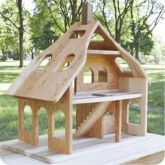 Camden Rose Three Story Cherry Wood Dollhouse by Palumba.com offering Waldorf dolls and natural toys $209.99
