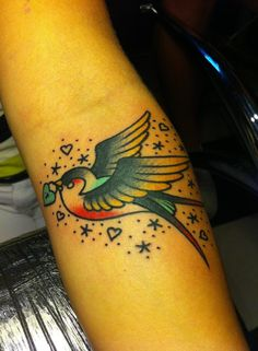 Traditional Swallow from Alex Roze at Hammersmith Tattoo really like the way Alex gave the traditional swallow tattoo a new school twist with the colours he chose!!