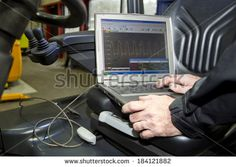 Laptop, hooked up to a forklift's engine and battery, performing various…