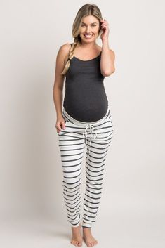 With a classic print and drawstring accent, we are in love with these lounge pants. Make a night in or a day around the house a fun occasion. You'll look and feel stylish even when you're dressed down. Simply style with your favorite basic tee for a cute look. #pregnancypants,