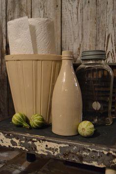 A vintage pot as a paper-towel holder - love it!!!