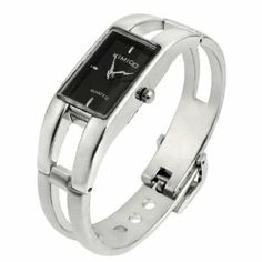 "Como Women Black Rectangle Dial Case Silver Tone Band Wrist Quartz Bracelet Watch by Como. $10.19. Product Name : Wrist Watch;Fit for : Ladies. Total Length : 16cm / 6.3"";Main Material : Alloy. Main Color : Silver Tone, Black;Weight : 49g. Package Content : 1 x Ladies Wrist Watch. Case Size : 2.5 x 1.8 x 0.7cm / 1"" x 0.7"" x 0.3""( L*W*T);Band Width : 1.2cm / 0.5"". Features with rectangle watchcase in silver tone, black rectangle dial, press buckle, 4 holes in total, hollow out de..."