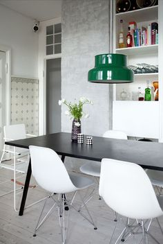 Kitchen inspiration: Charles Eames inspired dining chairs and a pop of retro colour on a light pendant.