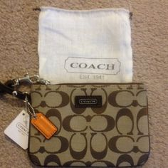 "SALE! NWT Coach khaki wristlet w/brown trim SALE!! NWT Coach khaki wristlet with brown patent leather trim.  Super cute & comes with a small dust bag!!!  Measures approx 6 1/2"" in length and 4"" in height. Coach Bags"