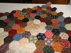 Finishing Tips  Now that you've been busy making hexagons, no doubtyouhave a wonderful assortment and want tobegin sewing them together....