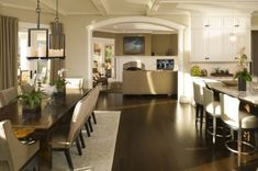 Like the lighting above the dining table.  wall color BM Grant Beige