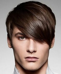 Men's hairstyle - hair long and brushed forward on top, short sides