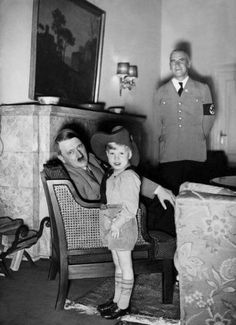 """Adolf Hitler with a young Donald in cowboy hat. Donald wanted a bright red baseball cap but """"Uncle Adolf"""" thought it was """"too bold,"""" and might give the boy """"ideas."""""""