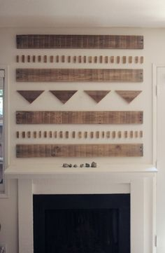 Wooden art over mantel