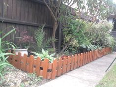 #PalletFence A small fence made from repurposed pallets to edge a border.