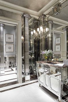 Custom-made mirrored surfaces transform a powder room into a glittering space. Cabinet and mirrors, John Himmel Decorative Arts; sink and fittings, Daum for THG; sconces, Niermann Weeks. - Veranda.com