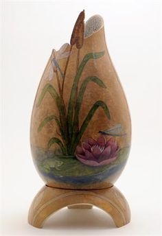 I love this, and the gourd stand, too. Gourd Art by Gloria Crane