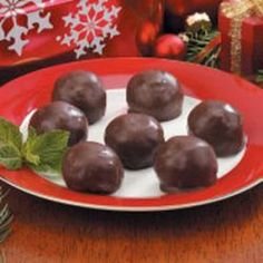 Crunchy Peanut Butter Balls Recipe Desserts, Lunch and Snacks with peanut butter, marshmallow creme, rice cereal, semi-sweet chocolate morsels, shortening