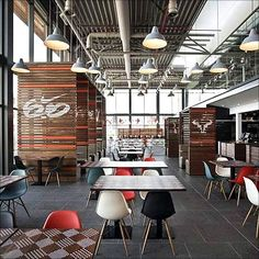 Very open with lots of colour and lines. The slat blinds are interesting and might be great at emulating the ceiling lines? This is NIKE European Headquarters in Hilversum, Holland.