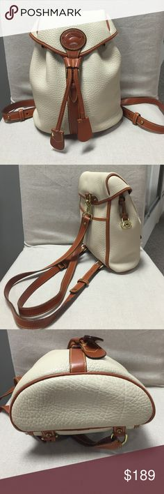 """Dooney&Bourke backpack Adorable vintage, made in USA, B 2 007613. Cream color, cognac trim and straps. 11"""" x 10 x 3 1/2"""". Straps are at 29"""" length now, adjustable. Clean inside, couple of pen marks - pic # 4. Outside no signs of damage , only by straps you can tell it was used. Cute as a button Dooney & Bourke Bags Backpacks"""
