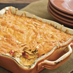 King Ranch Chicken Casserole | Filled with tomatoes and green chiles, creamy layers of chopped cooked chicken and corn tortillas make this Texas casserole too tempting to resist. It's super-easy to fix for a crowd, and always a hit.