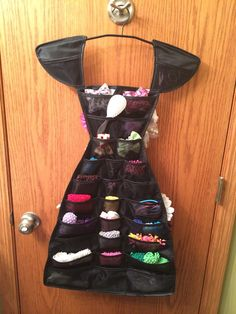 Jewelry dress turned little girl hair accessory display!
