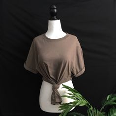 ✨safari knotted reworked tee✨ new  reworked knot crop top                                                                  color: safari one size fits s/m premium quality  100% cotton  custom made/custom color cut & knotted to create a signature vintage look   ❎ price firm ❎ no trades  be sure to share pictures of your new items  or of you wearing them! don't forget to tag  @joslyncapri #shopcapri on instagram and twitter!  c a p r i Tops Tees - Short Sleeve