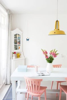 A pretty colorful home, pink + mustard yellow!