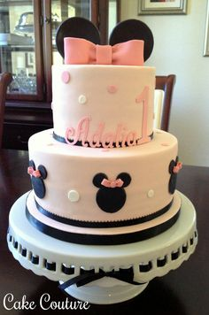 Minnie Mouse First Birthday Cake - Marshmallow Fondant with gumpaste accents. Love this design inspired by The Pastry Studio.