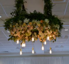 A giant floral chandelier is such a fun idea! Perfect for that 'first dance' photo