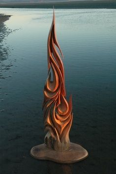 I think this driftwood sculpture looks really cool. All of the spiky and sharp edges combined with the red of a sunset gives it a sense of powerfullness. It also contrasts very nicely to the soft, blue water surrounding the sculpture.