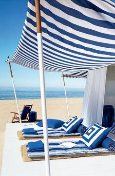 A canopy of striped blue and white fabric makes the perfect, lounge-worthy beach cabana. From Ralph Lauren Home Home Living, Coastal Living, Outdoor Spaces, Outdoor Living, Outdoor Decor, Outdoor Lounge, Beach Cabana, Beach Tent, Nooks
