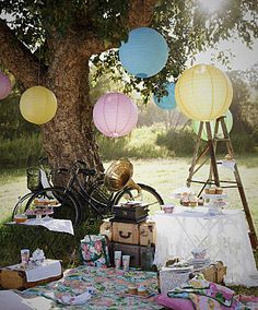 A Springtime picnic.  Love the ironing board as a table!
