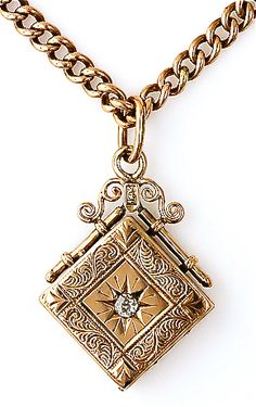 Victorian man's gold & diamond watch fab / locket. (It opens into several compartments,when you remove the pins) I have one similar to this.... my maternal grandfather's.