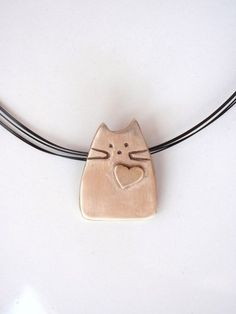 Cat pendant, modern design made of pure bronze, whimsical cat . - Cat pendant, modern design made of pure bronze, whimsical cat # - Diy Jewelry Rings, Cat Jewelry, Ceramic Jewelry, Ceramic Beads, Clay Beads, Polymer Clay Jewelry, Jewelry Ideas, Pendant Jewelry, Ceramic Pendant
