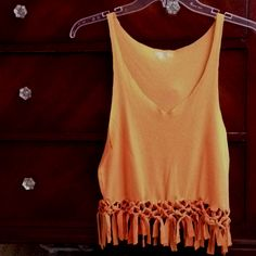 Cut up an old Tshirt and make it fashionable