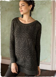 Our relaxed, lacy tunic is patterned with architectural motifs in quiet shades of putty and black. Jacquard knit of alpaca (80%) and cotton (20%), with a wide neckline, drop shoulders and ribbed trim.