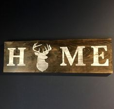 "HUNTING HOME DECOR/Antler Art/Nature Inspired Art/Nature Lovers Gifts/Man Cave Art/Man Cave Sign/Nature Decor/Woodland Decor/Home Wood Sign DETAILS: Deer Head * HOME* Wall Sign * Measures 7.5"" tall x 24"" wide * Includes hanging hardware The sign pictured is stained in Jacobean with distressed white lettering. COLORS: Your choice of background stain-green, grey, ebony, or jacobean. White CUSTOMIZA... * You can get additional details at the image link. #budgethomedecor"