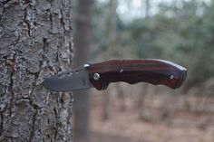 This BucknBear Folding Knife embraces the classic folder-lines, style and craftsmanship. The Damascus folder features with a hollow grind, an elongated nail clip, and clip point style. The elegant handle features Snakewood Comes with a molded stitched leather sheath.