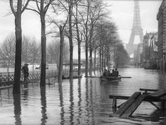 Rowing on the streets of Paris after the Seine River flooded, c. 1910.