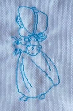 silueta niña en azul. punto de cruz. 2015