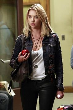 Rosewood's resident fashionista is always mixing up her look, going from glam brights to grunge-y darks. Patches on her denim jacket and layered necklaces, along with some seriously awesome black extentions take her edgy black skinnies to fashion-y new levels.     - Seventeen.com