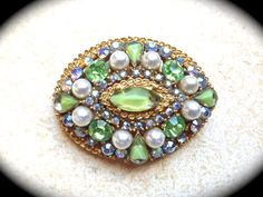 Signed ART Brooch, green Swarovski rhinestone and pearl signed brooch-very unique circa Mid Century   This beautiful gold tone brooch is surrounded by AB rhinestones, vario... #jewelry #vintage #christmas #gifts #etsy