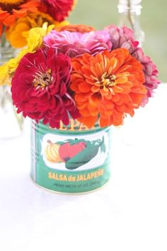 Colorful zinnias in empty salsa cans as vases along with empty bottles of Mexican soda / Cinco de Mayo / Fiesta Mexican Dinner Party, Mexican Fiesta Party, Fiesta Theme Party, Mexican Salsa, Taco Party, Baby Shower, Bridal Shower, Fiesta Party Decorations, Table Decorations