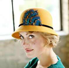 719a3cf6eb5 Mustard Womens Cloche Hat With Peacock BlueFeather Accent