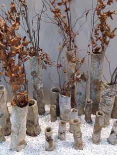 SEMPRE Belgium - What a perfect autumnal retail window. Concrete Vases - Maison & Objets September 2015